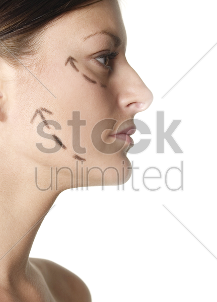 woman's face with arrows showing up stock photo