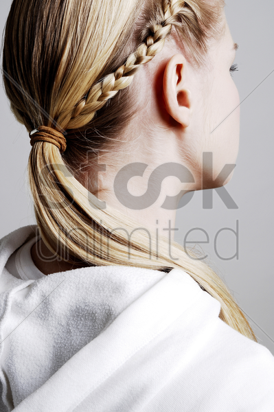 woman's hair in braids stock photo