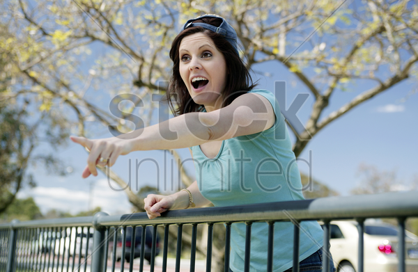 woman screaming while pointing stock photo