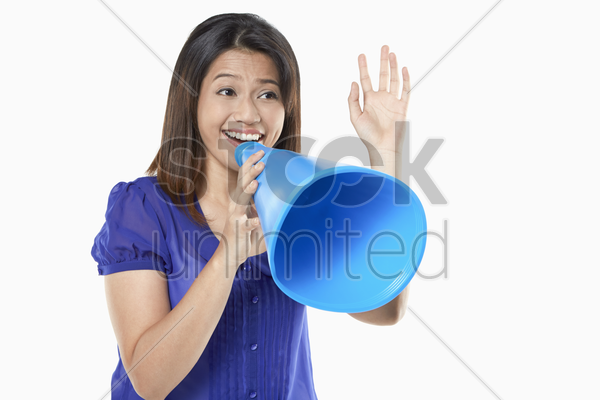 woman shouting into a megaphone stock photo