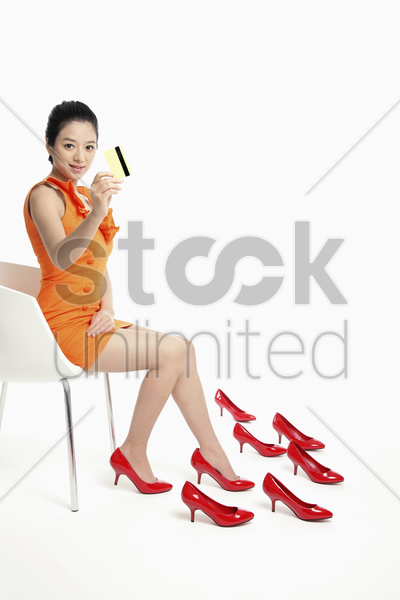woman showing credit card stock photo