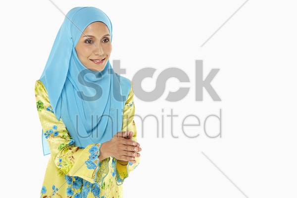 woman showing hand greeting gesture stock photo