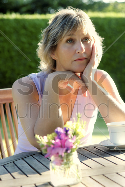 woman sitting alone stock photo