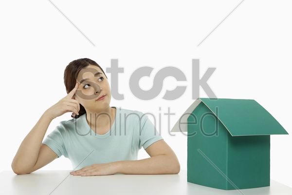woman sitting and contemplating stock photo