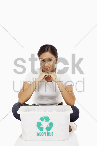woman sitting and smiling at the camera stock photo