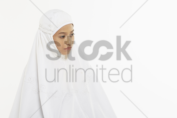 woman sitting between the two sujuds stock photo