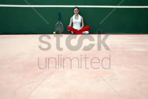 woman sitting in the tennis court stock photo