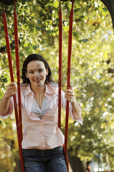 woman sitting on a swing stock photo