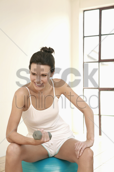 woman sitting on fitness ball stock photo