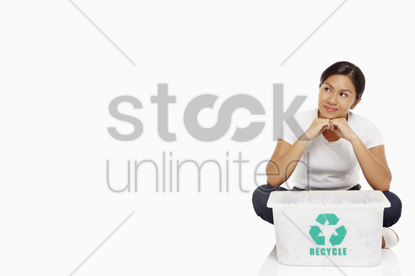 woman sitting on the floor, contemplating stock photo