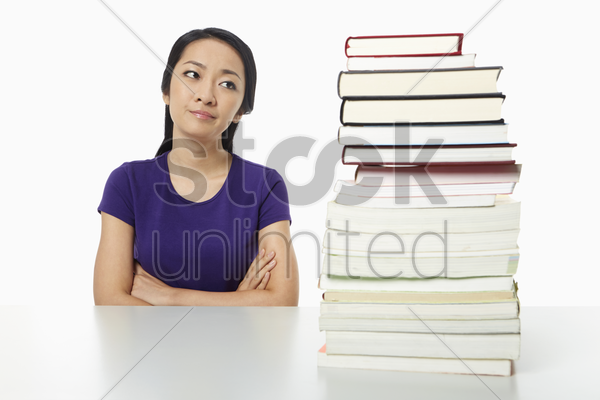 woman sitting with arms crossed stock photo