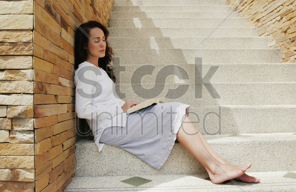 woman sleeping with a book her lap stock photo