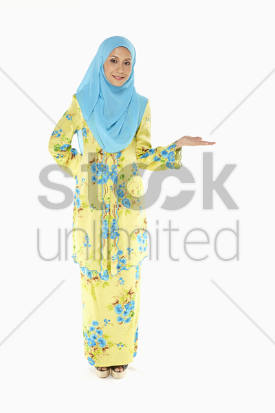 woman smiling and gesturing stock photo