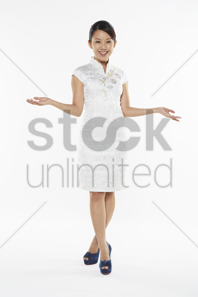 woman smiling and showing hand gesture stock photo
