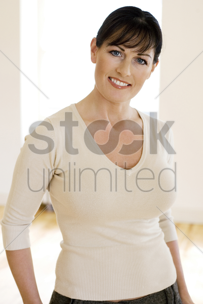 woman smiling at the camera stock photo