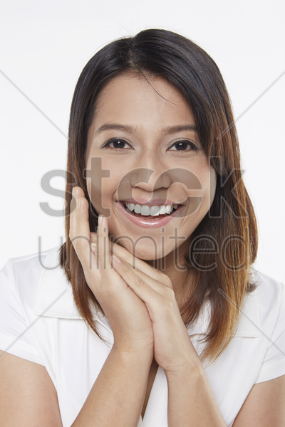 woman smiling cheerfully stock photo