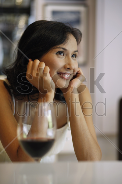 woman smiling while contemplating stock photo