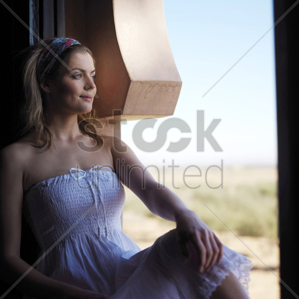 woman smiling while looking away stock photo