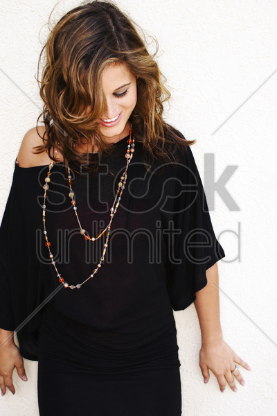 woman smiling while looking down stock photo