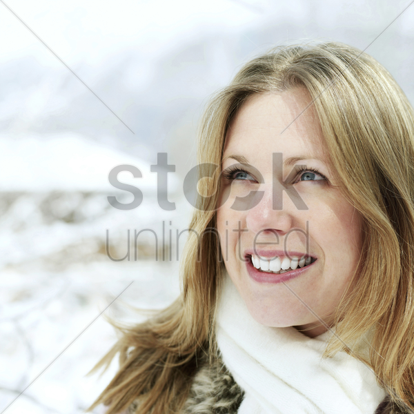 woman smiling while looking up stock photo