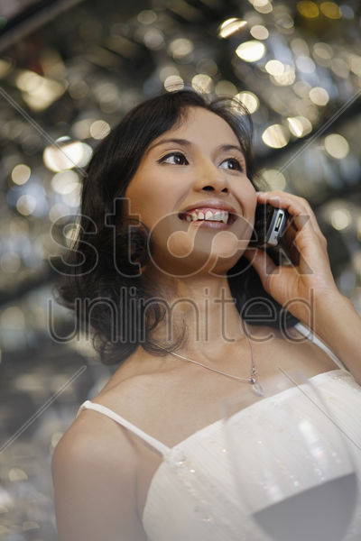 woman smiling while talking on the phone stock photo