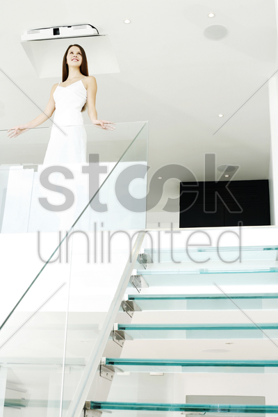 woman smiling while thinking stock photo