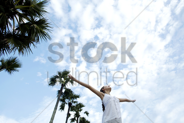 woman spreading her arms stock photo