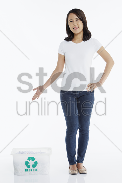 woman standing beside a plastic box stock photo