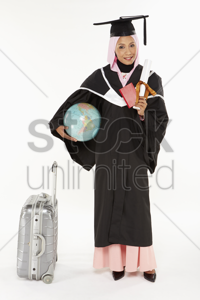woman standing beside a suitcase stock photo
