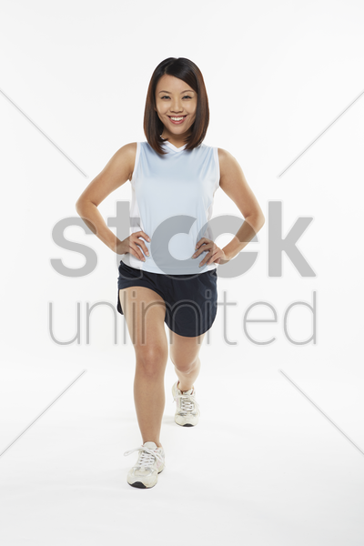 woman stretching and doing lunges stock photo