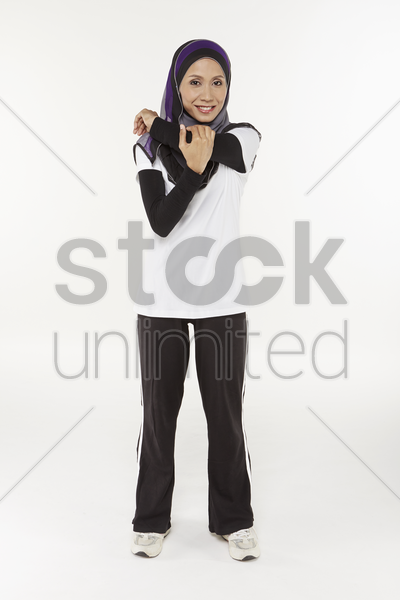 woman stretching arms stock photo