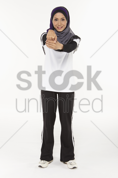 woman stretching fingers downwards stock photo