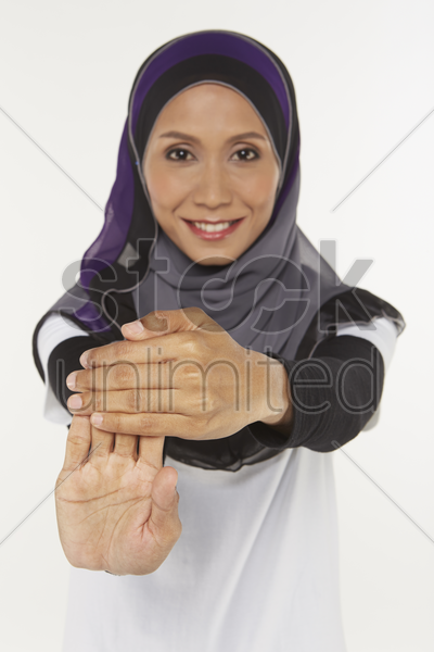 woman stretching fingers upwards stock photo
