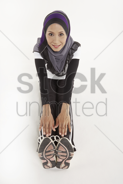 woman stretching legs and hands stock photo