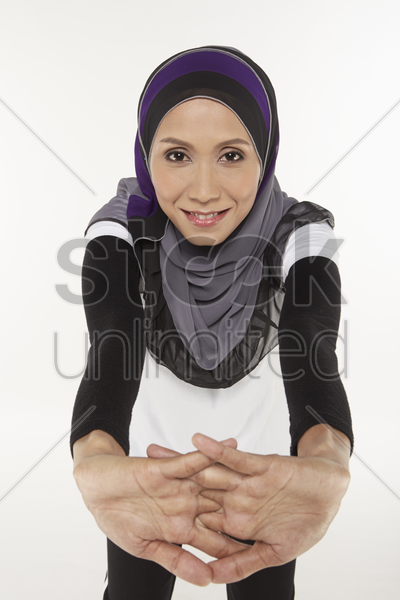 woman stretching, moving forward stock photo