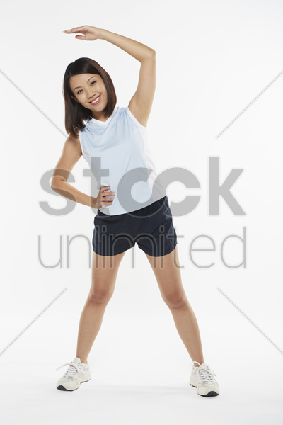 woman stretching to the right stock photo