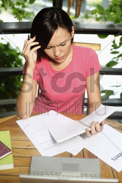 woman studying with laptop on the table stock photo