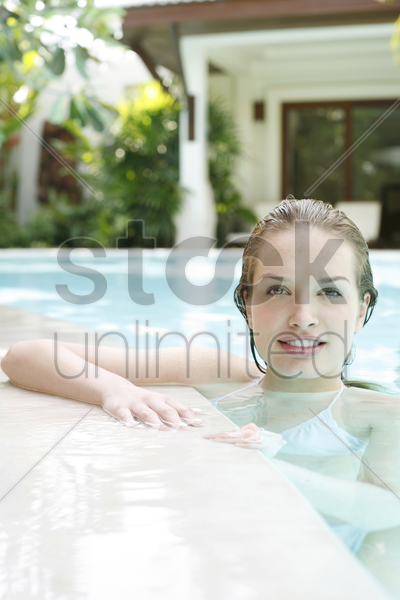 woman swimming in the pool stock photo