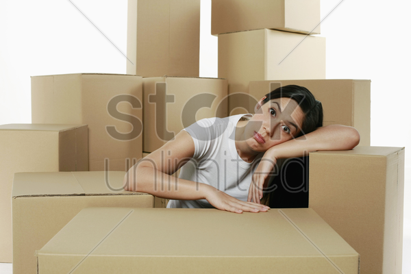 woman taking a break from unpacking stock photo