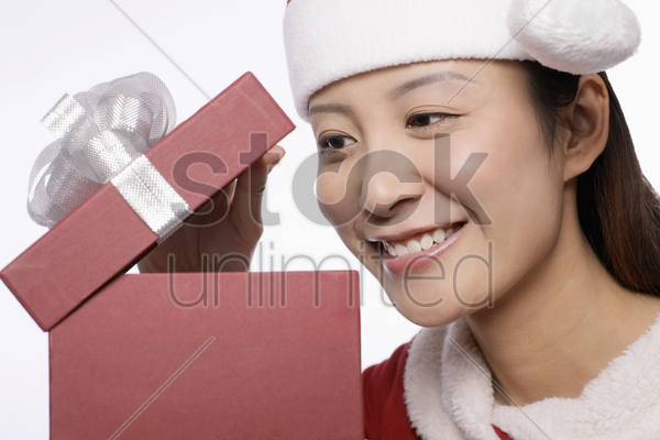woman taking a peek into her present stock photo