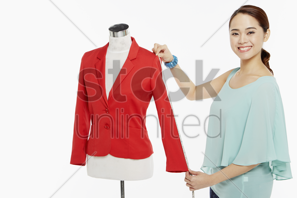 woman taking measurements stock photo