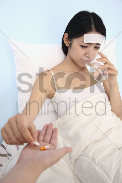 woman taking medicine stock photo