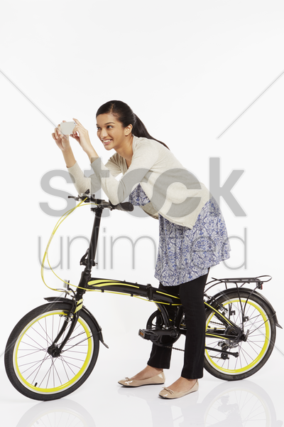woman taking pictures with her mobile phone stock photo