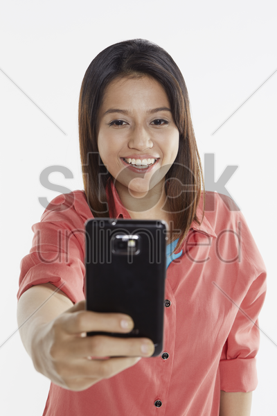 woman taking pictures with mobile phone stock photo