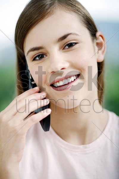 woman talking on the mobile phone stock photo