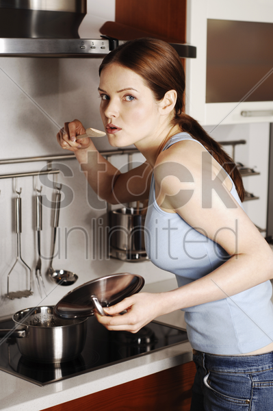 woman tasting soup stock photo