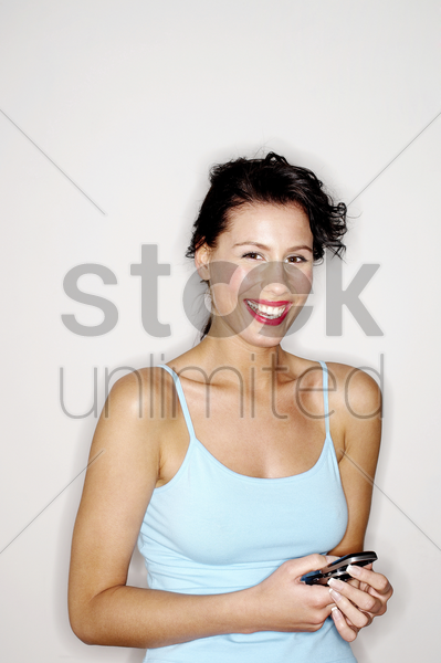woman text messaging on the mobile phone stock photo