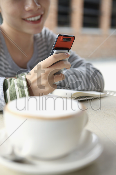 woman text messaging on the phone stock photo