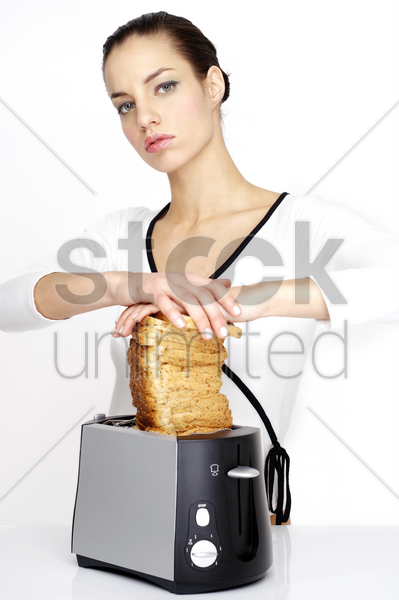 woman toasting breads stock photo
