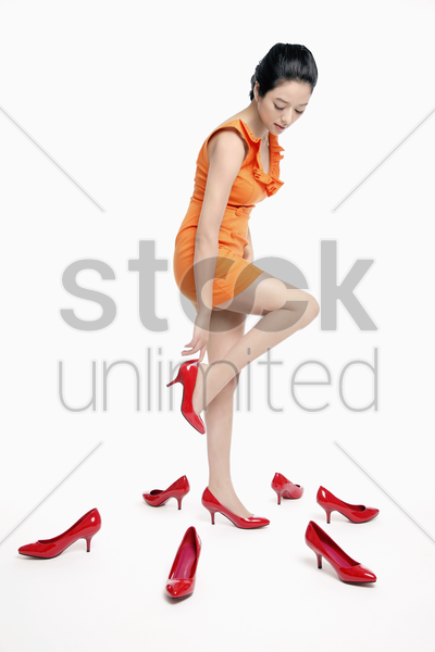 woman trying on shoes stock photo